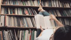 Woman reading relax on the library - stock footage
