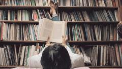 Woman reading relax on the library Stock Footage