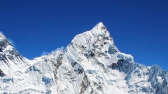 Mt Everest (left, 8850m) and Mt. Nuptse (right) in the Himalayas, Nepal - stock footage