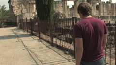 Young Man Walking  Around Capernaum Archaeological Park Stock Footage
