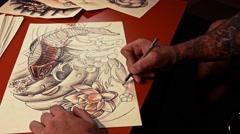 Tattoo-artist draws sketch Stock Footage