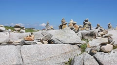Stock Video Footage of Stacked rock cairns at Peggys cove Nova Scotia