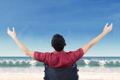 Disabled person enjoy freedom at coast - stock photo