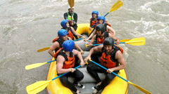 Whitewater rafting boat high angle Stock Footage