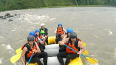 High angle shot of whitewater rafting boat Stock Footage