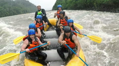 Up and down on whitewater rafting trip - stock footage