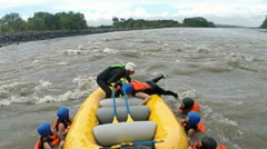 Whitewater river rafting rescuing sequence - stock footage