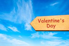 Directional wooden arrow with message VALENTINE DAY Stock Photos