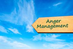 Directional wooden arrow with message ANGER MANAGEMENT - stock photo