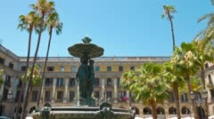 Plaza Real in Barcelona, establishing shot of fountain typical spanish building Stock Footage