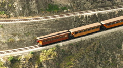 Touristic train at Nariz del Diablo on zig zag railway pattern due high altitude Stock Footage