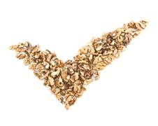 Yes tick shape made of walnuts Kuvituskuvat