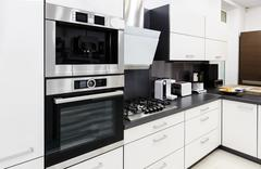 Modern hi-tek kitchen, clean interior design Stock Photos
