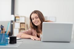 Young Office Woman with Laptop Smiling at Camera Stock Photos