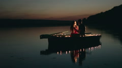 Stock Video Footage of Couple on romantic boat at night