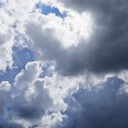 Sun hidden behind the clouds - stock photo