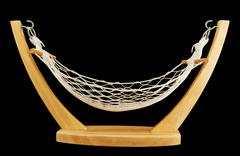 Hammock made of net and wood isolated Stock Photos