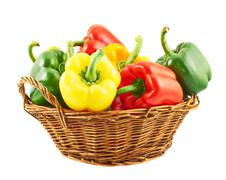 Wicker basket full of bell peppers Stock Photos