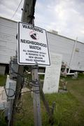Warning sign in yard after Hurricane Katrina, New Orleans, Louis - stock photo