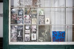 Vintage photographs in window in New Orleans, Louisiana Stock Photos