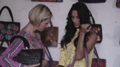 Women trying on handbags - stock footage