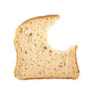 Bitten slice of bread - stock photo
