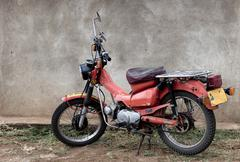 Stationary red motorcycle, Tanzania, Africa Stock Photos