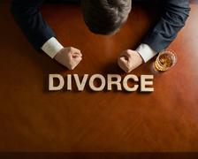 Word Divorce and devastated man composition Stock Photos