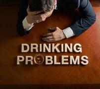 Phrase Drinking Problems and devastated man composition Stock Photos