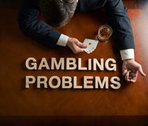 Phrase Gambling Problems and devastated man composition Stock Photos