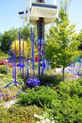 Purple blown glass tubes in Garden - stock photo