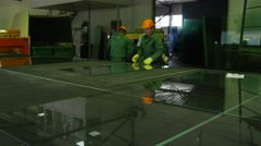 Three Workers Are Carefully Taking Out The Cut Sheets From the Table, Workers Stock Footage