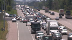 Bumper to bumper traffic jam on highway 400 north of Toronto headed for cottage Stock Footage