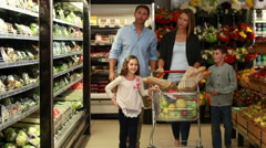 Happy family grocery shopping together Stock Footage