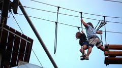 Climbing dad with small kid in rope park Stock Footage
