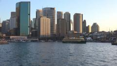 Sun setting over Sydney CBD as ferry departs Stock Footage
