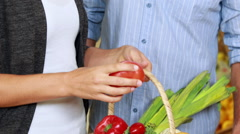 Couple picking out vegetables in grocery store Stock Footage