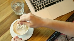 Stock Video Footage of Woman drinking coffee and using digital tablet in the coffee shop