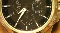 close-up of face of a wrist watch with second hand ticking off time - stock footage