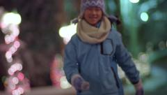 Happy Girl Skips Down Road Lined With Beautifully Lit Christmas Trees - stock footage