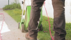 Home Yard Gardening - Electrical Lawn Mowing Real Time Stock Footage