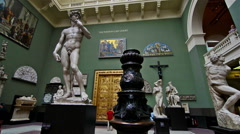 London. United Kingdom. Visitors in Victoria and Albert museum Stock Footage