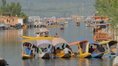 Crowded shikara boats on Dal Lake in late afternoon,Srinagar,Kashmir,India Stock Footage
