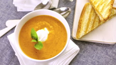 Roasted tomato soup cooked with organic heirloom tomatoes and served with grille Stock Footage