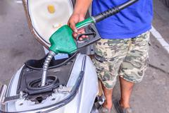 Oil fueling to motorcycles. - stock photo
