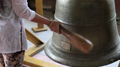 Women hit bell in the temple. Stock Footage