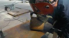 Welder cutting steel billet Stock Footage