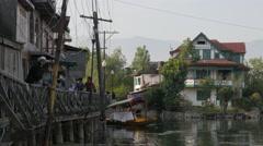 People walk along Dal Lake,Srinagar,Kashmir,India - stock footage