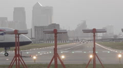 A passenger plane taxying onto the runway Stock Footage