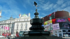 London. United Kingdom. Eros statue and buses in quiet Piccadilly - stock footage